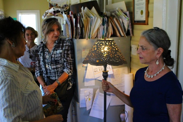 Kathleen Trenchard (R) points out a laser-cut lampshade she designed in the papel picado style. Photo by Page Graham.