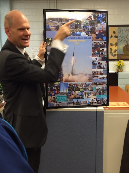 AHISD Superintendent Kevin Brown shows off a collage of photos from the 2012 Alamo Heights HS rocket launch. photo by Bekah McNeel