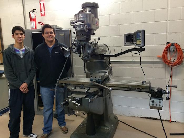 Luis Petitjean (left) and Daniel Moncera show off the rocket shop. Photo by Bekah McNeel.