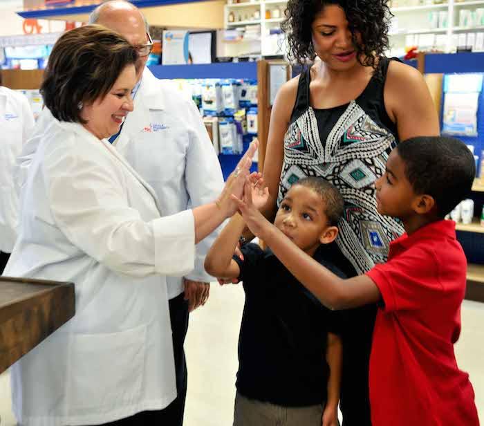 Leticia Van de Putte serves patients at the pharmacy. Courtesy photo.
