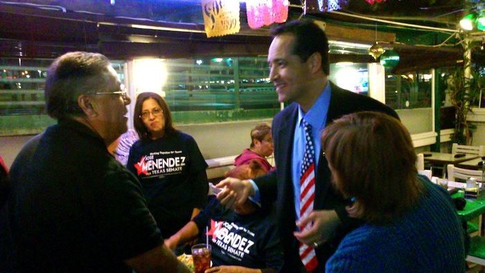 State Rep. José Menéndez greets supporters at a runoff election watch party Tuesday night at Cha-Cha's restaurant. Photo by Edmond Ortiz.