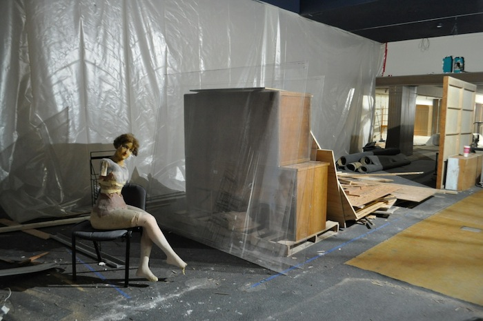 Strange props and packed boxes fill an exhibit space in the Witte Museum. Photo by Iris Dimmick.