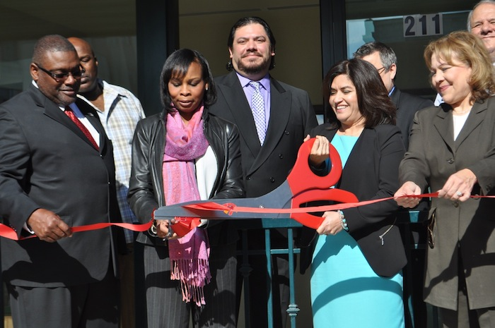 (From left) Chair of SAHA's Board of Commissioners Morris Stribling, Mayor Ivy Taylor, SAHA President and CEO Lourdes Castro Ramírez, and Tammye Treviño, HUD regional administrator, cut the ceremonial ribbon at the grand opening of SAHA's Lofts at Marie McGuire. Photo by Iris Dimmick.