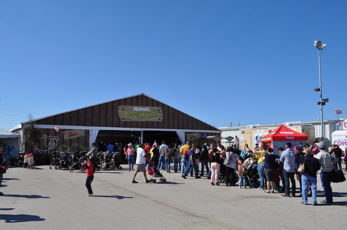 A long line for the Huggies Petting Zoo during the 2013 San Antonio Stock Show and Rodeo. Photo by Iris Dimmick.