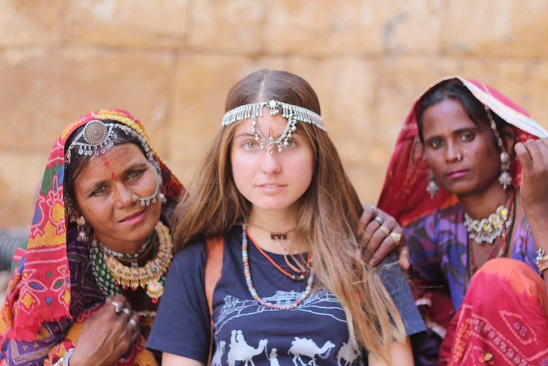 I pose with two women selling jewelry in Jaisalmer, India. Photo by Bobby Vinson.