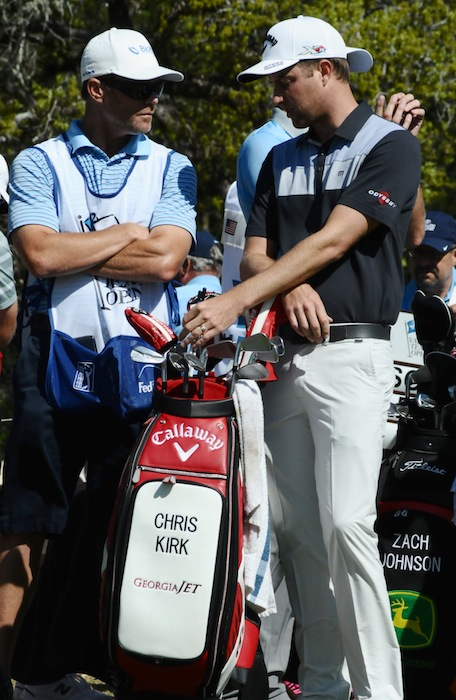Atlanta, Georgia's own Chris Kirk confers with his caddy before he tees off at the final round of the 2015 Valero Texas Open at the JW Marriott TPC San Antonio. Photo by Kristian Jaime.