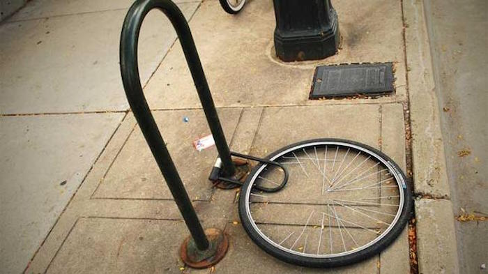 A bike locked by its wheel only will not deter thieves. Photo via Flicker user Quan Ha.