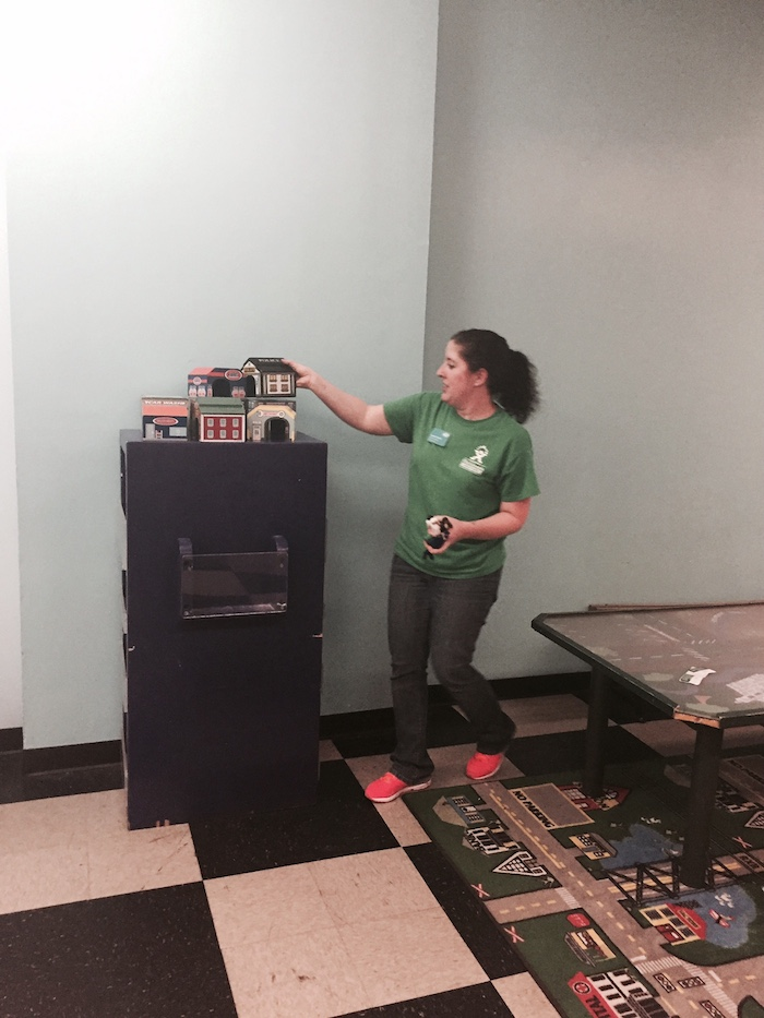 Jennifer Ireland, a Discovery Leader with the museum, picks up for the very last time. Like all the current staff, Ireland will work at The DoSeum, which is hiring to add staff, given that it's three times the size of the now closed museum. Photo by Tracy Hamilton.