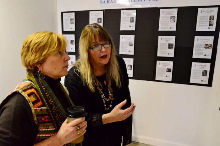 Tami Kegley and Michael Ann Coker discuss some of the memorabilia on display at Tex Pop. Photo by Page Graham.