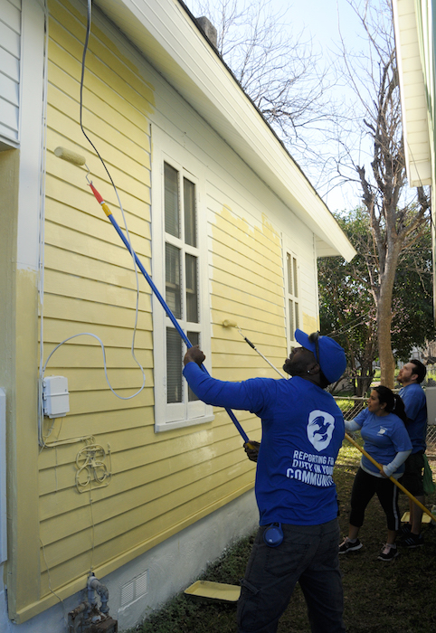 Edwin Henderson reaches the hard-to-reach spots during the EastPoint Shine Paint-A-Thon. Photo by Kristian Jaime.