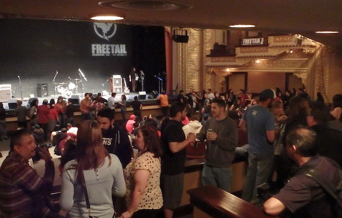 Guests enjoy Freetail Beer while waiting for the concert to begin at the Empire Theatre. Photo by MIles Terracina.
