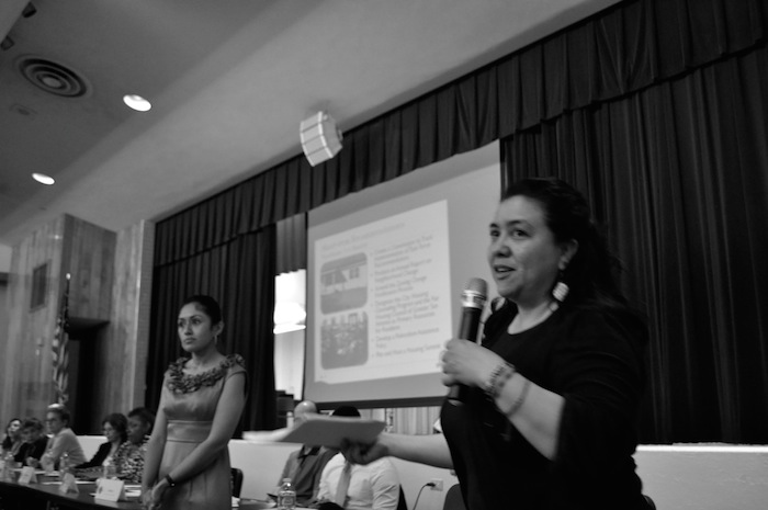 Jessica O. Guerrero (right) speaks while Iris Duran, program manager for the City's planning department (and temporary translator), looks on during the first Gentrification Task Force town hall meeting at Tafolla Middle School. Photo by Iris Dimmick.
