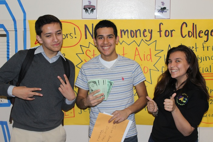 Members of the College Advising Corps and San Antonio Education Partnership celebrate a student's completed FAFSA at McCollum. Courtesy photo.