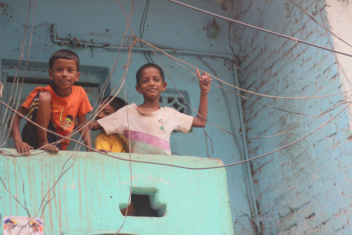 At the Dharavi slum in Mumbai, which is one of the largest slums in the world. Despite living conditions, smiles were abundant. Photo by Joan Vinson.