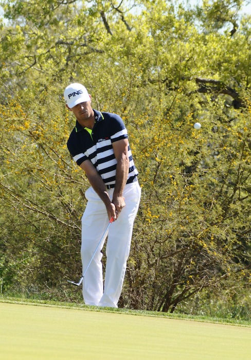 Jordan Spieth chips to get back on the green during the 2015 Valero Texas Open. Photo by Kristian Jaime.