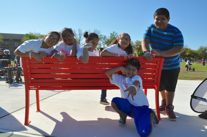 A playful kids pose for the camera during the Labor Street Park grand opening. Photo by Iris Dimmick.