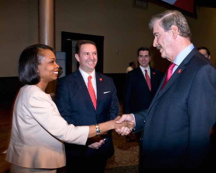 Mayor Ivy Taylor and Former President of Mexico Vicente Fox shake hands before a  Mexican Business Leaders Association luncheon on March 16, 2014. Photo by Al Rendon.