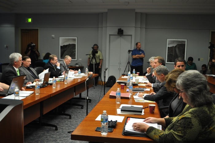Police union (left) and City (right) negotiating teams meet to discuss the police union's counter proposal. Photo by Iris Dimmick.