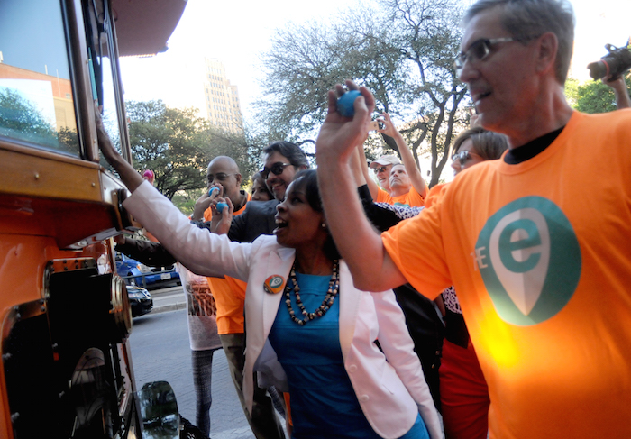 San Antonio Mayor Ivy Taylor prepares to welcome the latest trolly to the the downtown fleet with some cascarones during the inaugural run of The E from Via Metropolitan Transit. Photo by Kristian Jaime Photography.