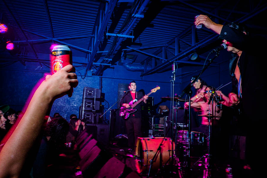 A member from The Spits raises his cup at the Paper Tiger opening weekend in March 2015. Photo by Scott Ball.