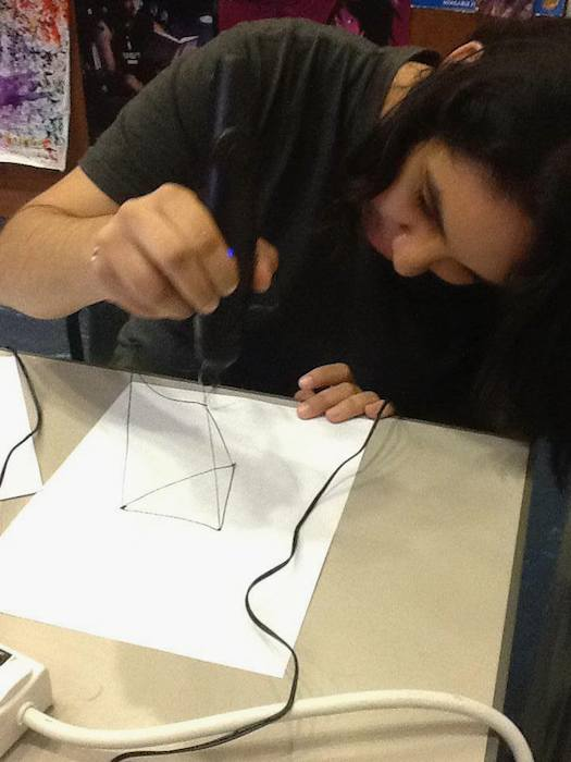 A teen designs objects using a 3D pen during Teen Tech Week at the San Antonio Public Library. Photo Courtesy of Teen Services at the San Antonio Public Library.