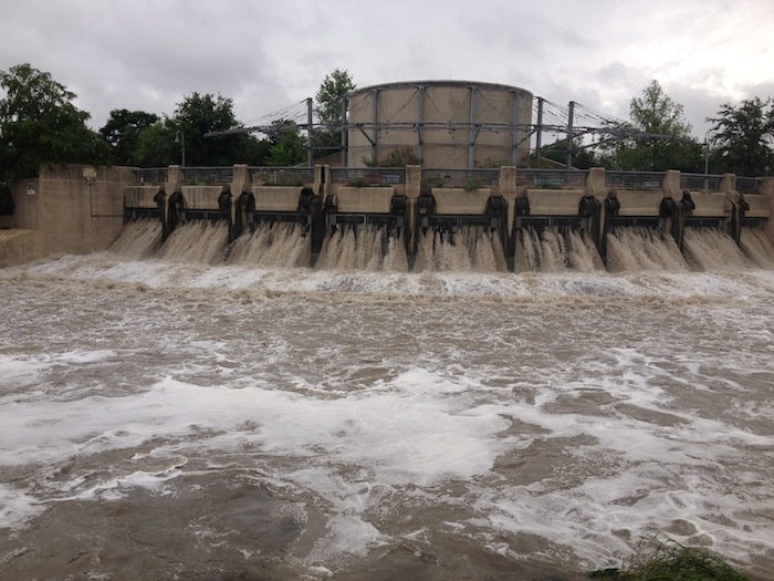 Floodwaters pour from the outlet of the San Antonio River Tunnel during a storm in May 2014. Decades ago, these waters would have flooded the city and left a wake of death and destruction. The 2012-2017 bond program will put over $128 million toward flood control and drainage projects. Photo by Robert Rivard.