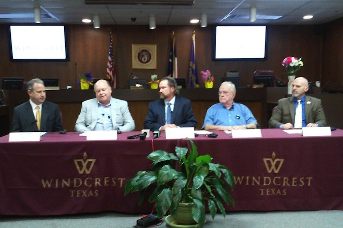 Windcrest Economic Development Corp. President Tim Maloney (second from left) speaks in a Wednesday morning news conference about how Bexar County suburbs are trying to keep Uber and other ride-sharing companies operating in spite of San Antonio's new rules. From left are Alamo Heights Mayor Louis Cooper, Windcrest Mayor Alan Baxter, Olmos Park Mayor Kenneth Farrimond and Hollywood Park Mayor Chris Fails. Photo by Edmond Ortiz