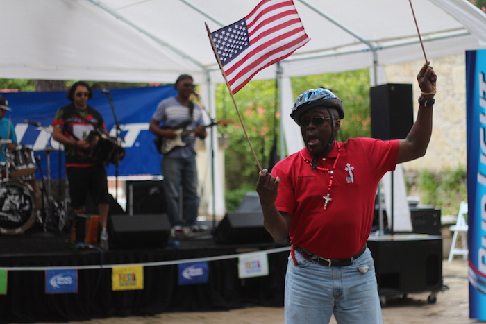 A patriotic patron dances at the Budweiser stage during the Fiesta Arts Fair. Photo by Joan Vinson.