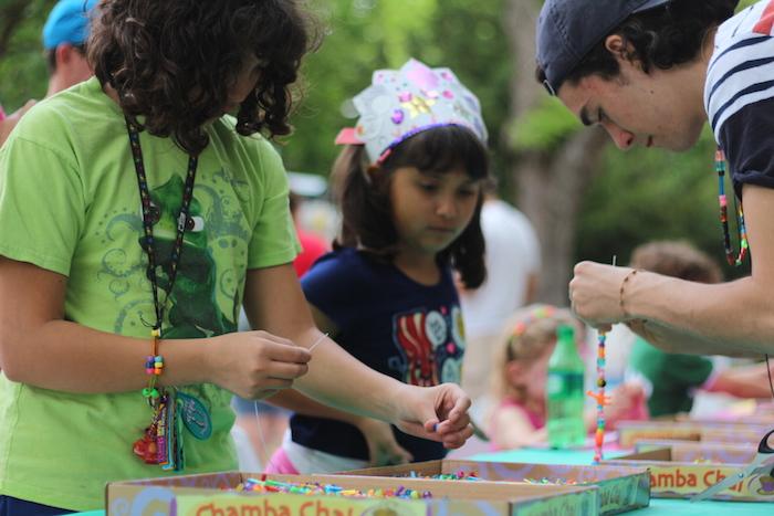 Beads were strung at the Children's Art Garden. Photo by Joan Vinson.