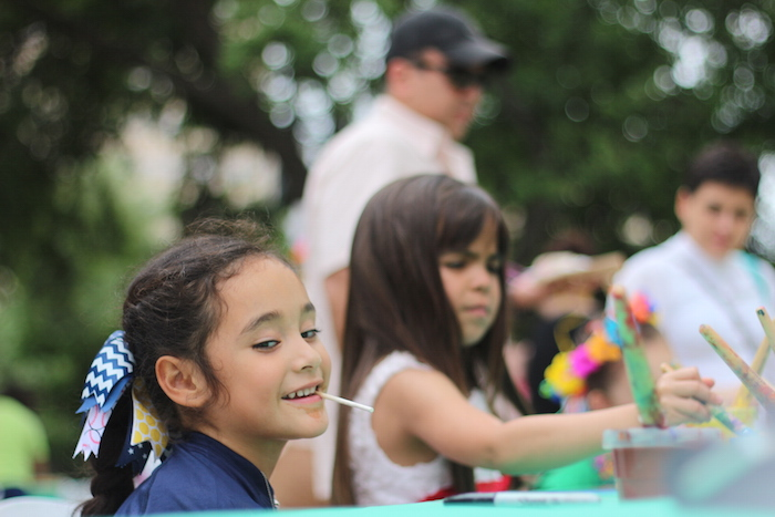 The Children's Art Garden provided a table for painting during the Fiesta Arts Fair. Photo by Joan Vinson.