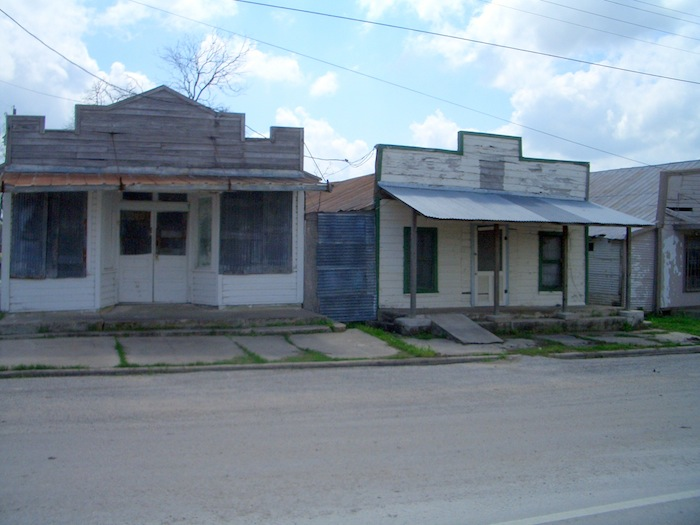 Abandoned buildings line streets near Karnes County Civil Detention Center. Photo by Lily Casura.