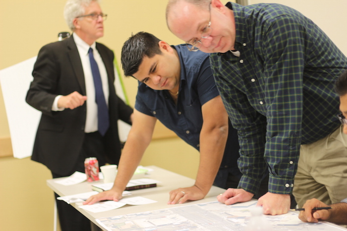 Workshop attendees design a bicycle lane plan during the Bicycle Facility Design Workshop. Photo by Joan Vinson.
