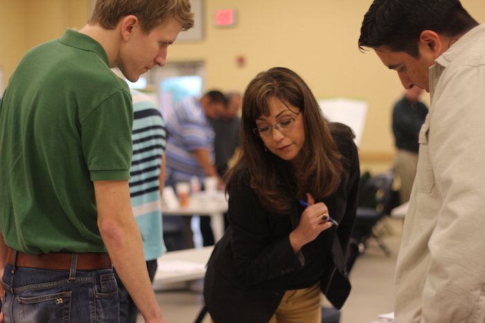 Attendees discuss bicycle lane possibilities during the Bicycle Facility Design Workshop. Photo by Joan Vinson.