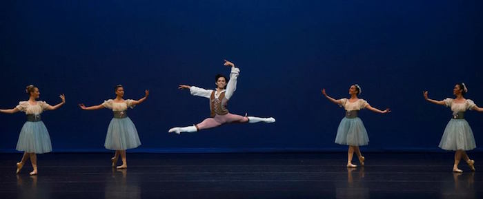"""Jayson Pescasio soars with corps de ballet members in Balanchine's """"Donizetti Variations."""" Photo by Alexander Devora."""
