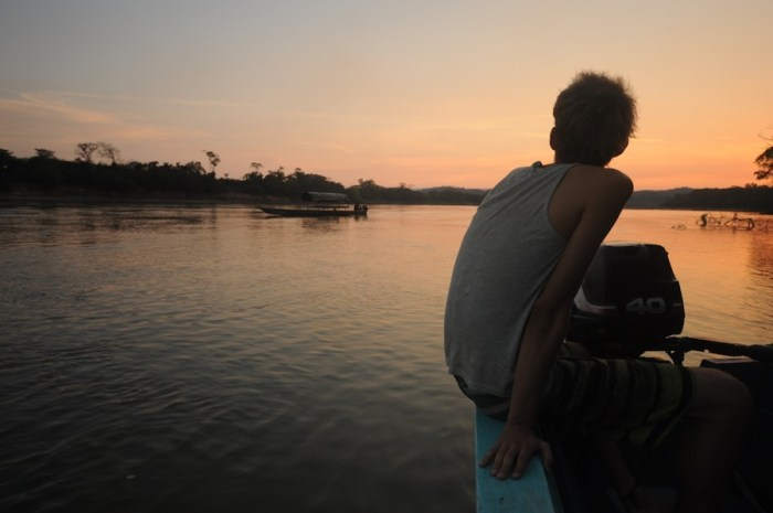 Andres in the lancha on the Usumacinta River. Photo by Everett Redus.