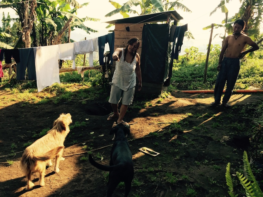 Jenss and Deviana playing with the dogs in Guatemala. Photo by Everett Redus.