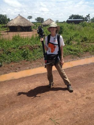 Heather Chandler poses with her camera in Uganda. Courtesy photo.