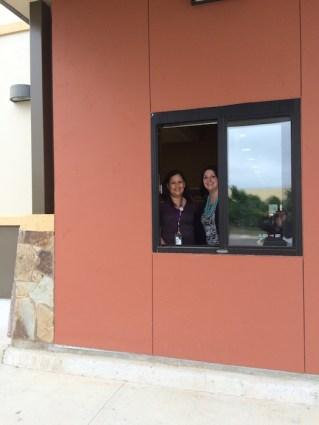 Marcie Hernandez and Keri Moczygemba manning the drive-thru at SAPL's Encino Branch. photo by Bekah McNeel
