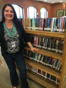 Branch manager Keri Moczygemba with some new books at SAPL's Encino Branch. photo by Bekah McNeel