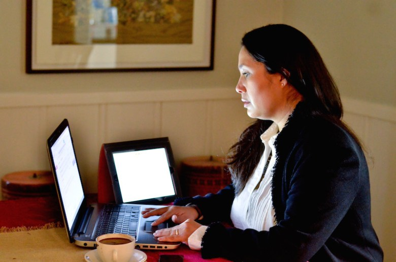 District 7 candidate Mari Aguirre-Rodriguez surrounded with technology. Courtesy photo.