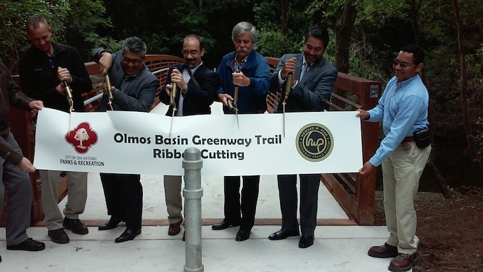 (From right to left with shears in hand) Councilmember Roberto Treviño (D1), former Mayor Howard Peak,Parks and Recreation Special Projects Manager Brandon Ross, and Parks and Recreation Director Xavier Urrutia cut the ceremonial ribbon for the Olmos Basin Park trailway.