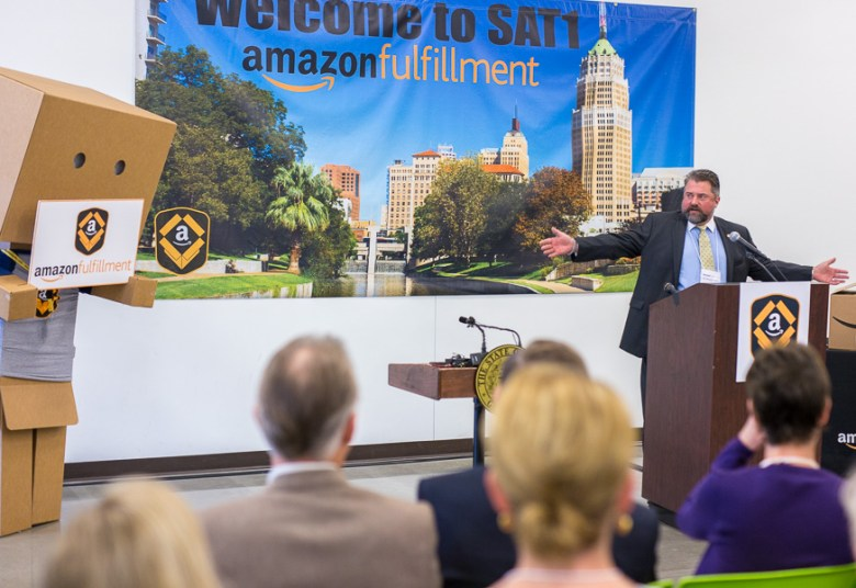 Schertz mayor Michael Carpenter addresses the audience Governor Greg Abott receives a tour at the Amazon Fulfillment Center.  Photo by Scott Ball.