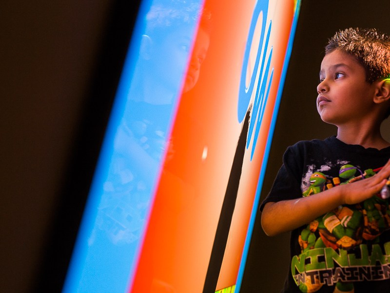 A young child stares into an interactive white board during an exercise at the Autism Treatment Center of San Antonio. Photo by Scott Ball.
