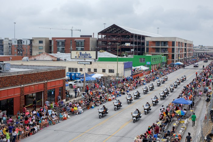 San Antonio Police Department motorcycle officers ride down Broadway during the 2015 Battle of Flowers Parade in downtown San Antonio. Photo by Scott Ball.