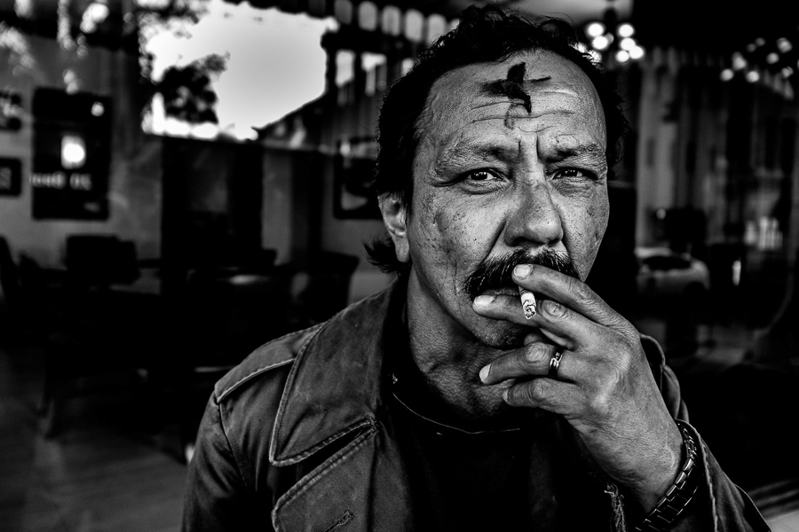 A street portrait of a man on Ash Wednesday in downtown San Antonio. Photo by Scott Ball.