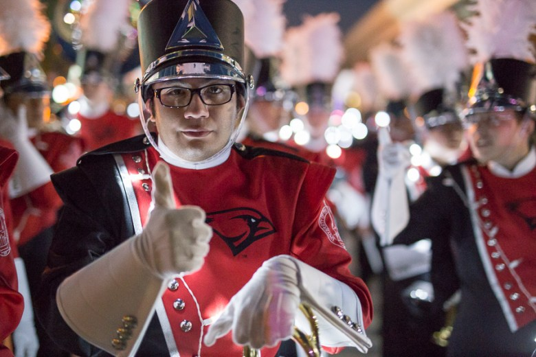 A UIW band member during the Fiesta Flambeau Parade in downtown San Antonio. Photo by Scott Ball.