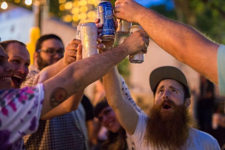 Festival attendees celebrate beer at the La Villita Historic Arts Village during Maverick Music Festival 2015.