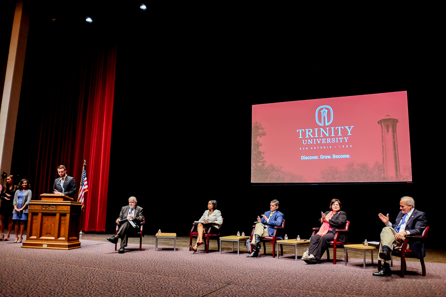 Trinity University students introduce the mayoral candidates at Trinity University during its mayoral forum. Photo by Scott Ball.