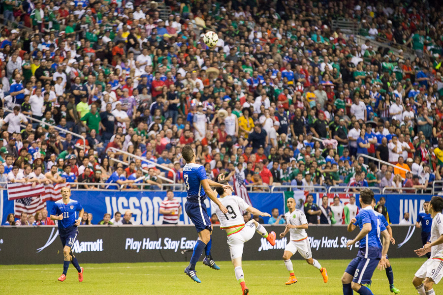 Players jump for position at the USA vs Mexico friendly match at the Alamodome. Photo by Scott Ball.