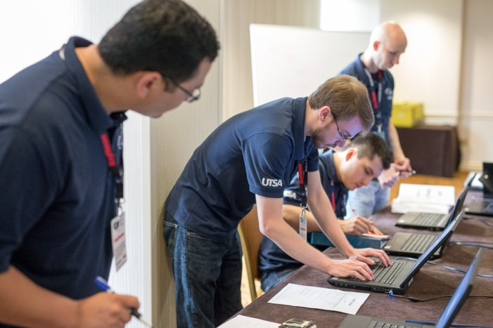 Justin Gray works during the 2015 National Collegiate Cyber Defense Competition. Photo by Scott Ball.